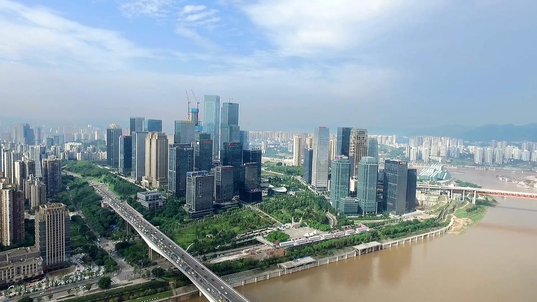 蓝云天空中近河现代城市鸟瞰